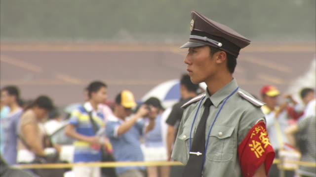 a young officer stands on patrol in beijing's tiananmen square, china. - military recruit stock videos & royalty-free footage