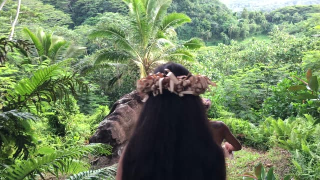 young pacific islander couple walking on a rain forest path in the highlands of rarotonga cook islands. - pacific islanders stock videos & royalty-free footage