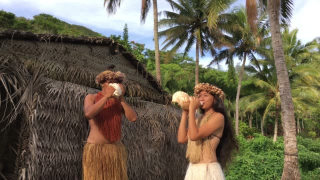 young pacific islander man and woman blowing conch shells in a maori village in the highlands of rarotonga cook islands - rarotonga stock videos & royalty-free footage