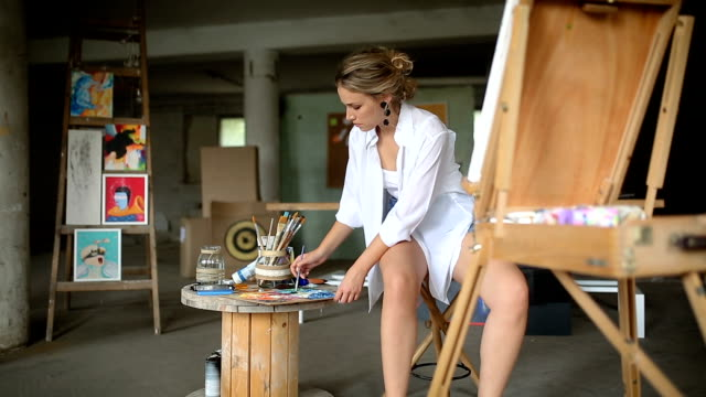 young painter woman - easel stock videos and b-roll footage