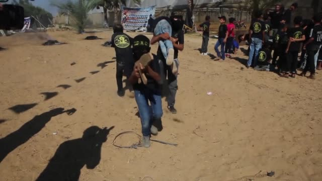 young palestinians took part on thursday in a military style exercise at a summer camp organised by the islamic jihad movement in khan yunis in the... - military camp stock videos & royalty-free footage