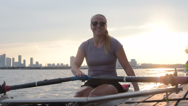 young paralyzed woman rowing. - sculling video stock e b–roll