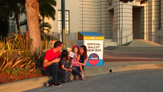 young parents and their kids mail their ballots in passadena - us president stock videos & royalty-free footage