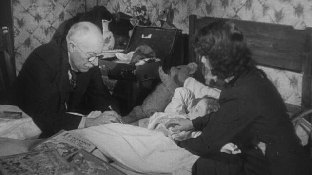 1941 montage a young patient being treated for diphtheria and recovering to walk out with her mother / united kingdom - diphtherie stock-videos und b-roll-filmmaterial