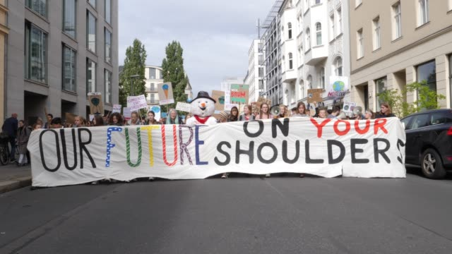 young people and students and participantst protest at the fridays for future movement during a nationwide climate change action day in front of the... - climate stock videos & royalty-free footage