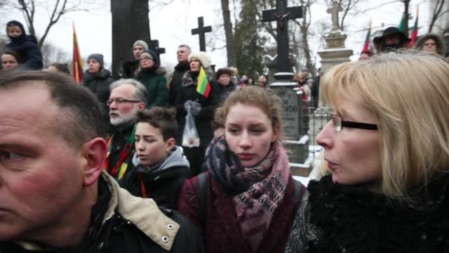 Young people attend a ceremony to honor Reinstatement Act signatories buried at Rasos Cemetery during the 100th anniversary of the restoration of...