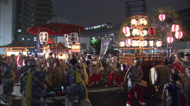 Young people beat drums at the opening of the Kokura Gion Daiko festival in Japan.