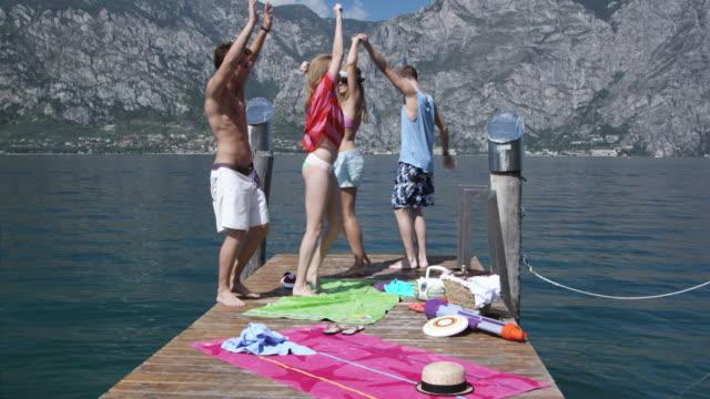 stockvideo's en b-roll-footage met young people dancing on landing stage - steiger pier