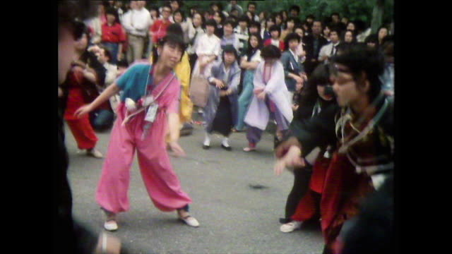 young people dancing together in the street; tokyo, 1981 - bbc archive stock-videos und b-roll-filmmaterial
