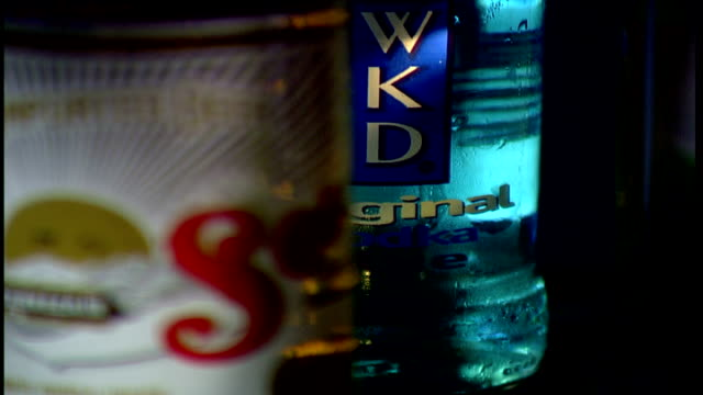 dangers of alcohol int close shot top taken off bottle of lager close shot bottle of wkd bottles of bacardi breezer smirnoff ice and peroni lager... - lager stock videos & royalty-free footage