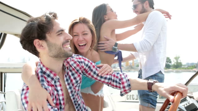 hd: young people drive yacht and having fun. - millionnaire stock videos and b-roll footage