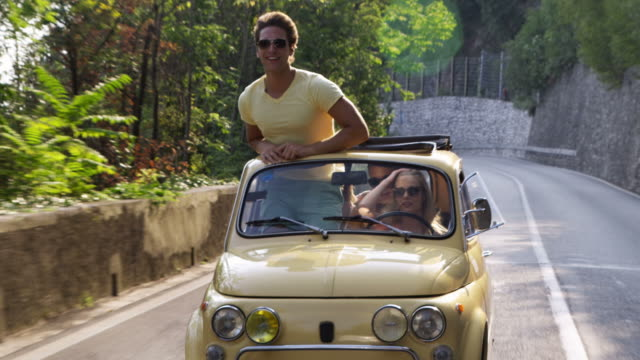 young people driving car - italy stock videos & royalty-free footage