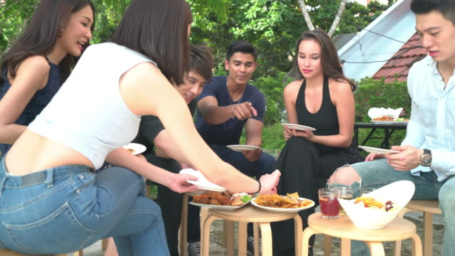 Young people eating and drinking rooftop Party
