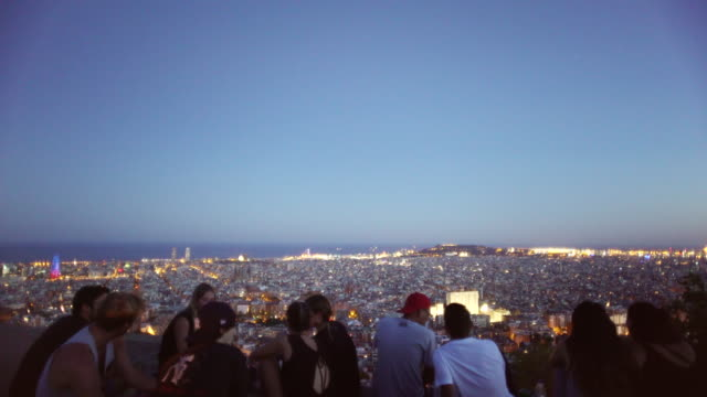 Young people enjoying the best Barcelona lookout / aerial / high angle point of view.