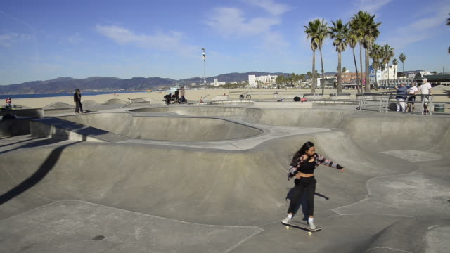 young people enjoying the skate park at venice beach in venice, california - skateboard park stock videos & royalty-free footage
