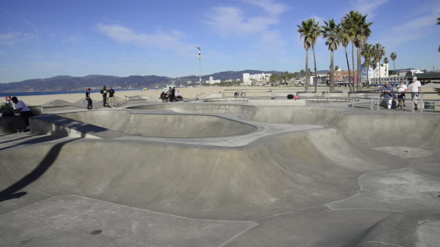 Young people enjoying the skate park at Venice Beach in Venice, California