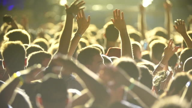 young people having fun at music concert - arms raised stock videos & royalty-free footage