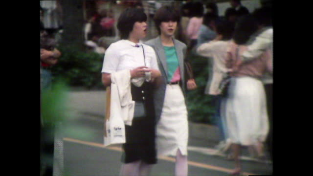 young people in 1980s fashion walk on tokyo streets; 1981 - design stock videos & royalty-free footage