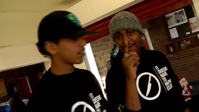 young people in east london campaign against knife crime ext unidentified teenager interview sot reporter along with teenagers teenagers peeling... - christmas cracker stock videos and b-roll footage