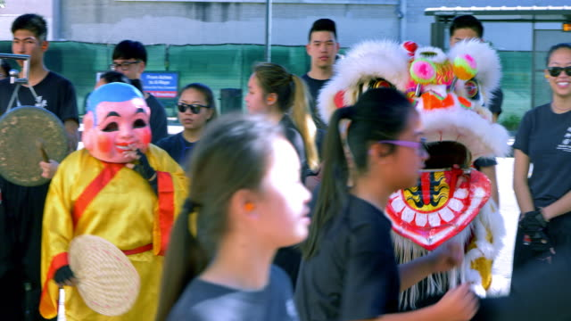 young people in traditional dress play drum and perform judo and karate martial arts training celebrating chinese new year with dragon in los angeles chinatown, california, 4k - drum percussion instrument stock videos & royalty-free footage