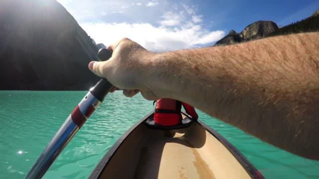 Young people Kayaking on Lake Louise Alberta Canada