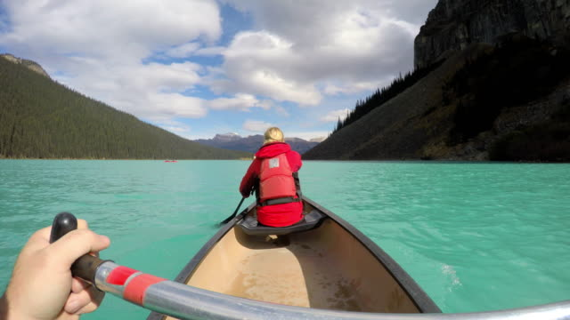 Young people Kayaking on Lake Louise Alberta Canada