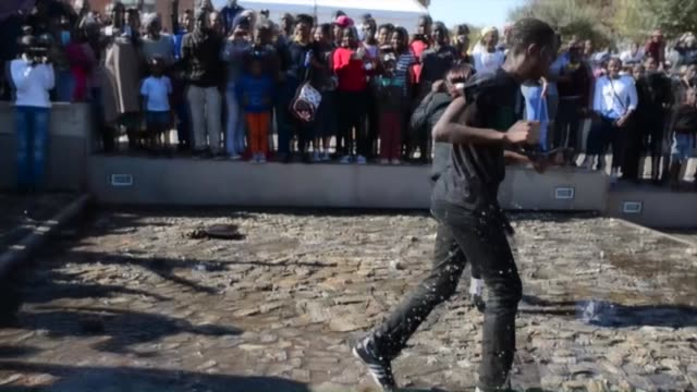 young people mostly including the supporters of eff march and shout slogans as they commemorate the 39th anniversary of the youth day in johannesburg... - soweto stock videos and b-roll footage