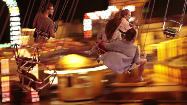 Young people on chairoplane