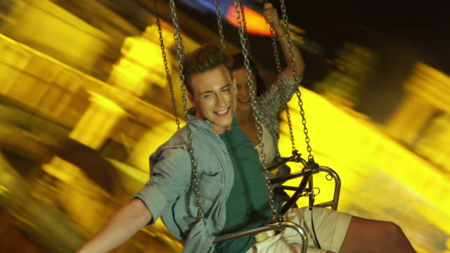 young people on chairoplane - fairground ride stock videos & royalty-free footage