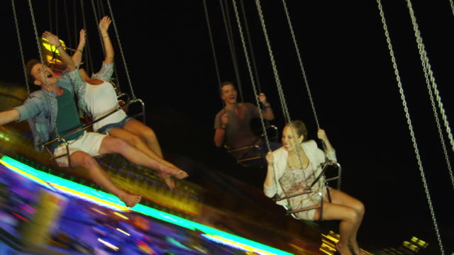 stockvideo's en b-roll-footage met young people on chairoplane - zweven