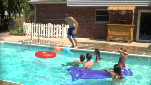ms, young people playing in swimming pool, middlesex, new jersey, usa, ha - inner tube stock videos and b-roll footage