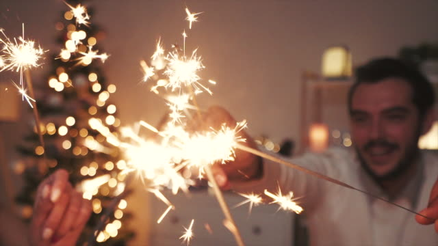 young people playing with sparklers. - small group of people stock videos & royalty-free footage