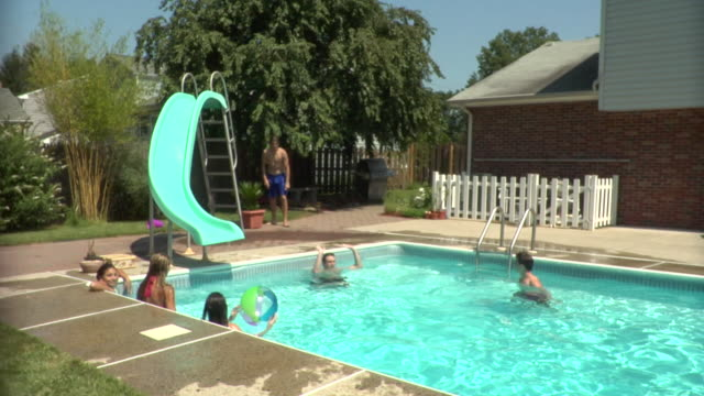 WS Young People Relaxing In Swimming Pool Middlesex New Jersey USA