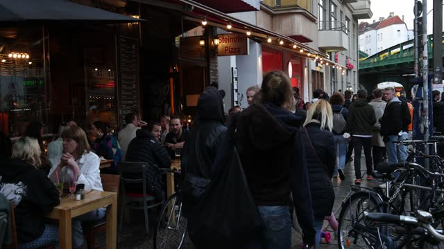 young people sit outside at a bar in kastanienallee avenue in prenzlauer berg district in the evening for the first time this year during the... - young adult stock videos & royalty-free footage