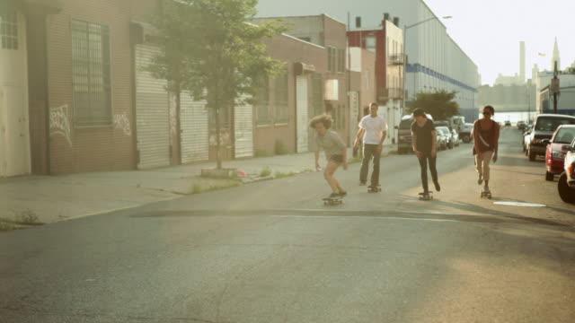 Young people skateboarding in urban setting