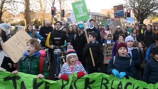 young people take part in the youthstrike4climate march through cambridge and london to raise awareness about climate change and the future of the... - person in education stock videos & royalty-free footage