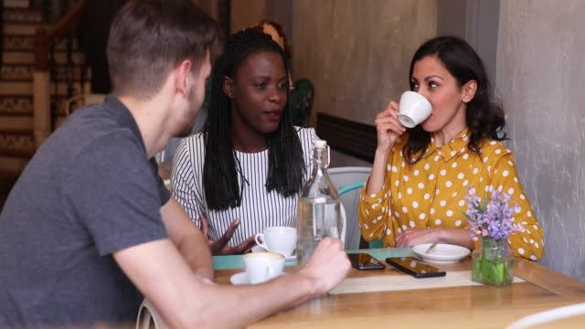 young people talking and drinking coffee - real life stock videos & royalty-free footage