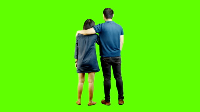 young people talking on green background. - green background stock videos & royalty-free footage