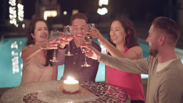 young people toasting at a party - swimming pool stock videos & royalty-free footage