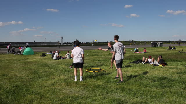 young people, who said they did not mind being photographed, play a ball game at tempelhofer feld public park during the coronavirus pandemic on may... - sporting term stock videos & royalty-free footage