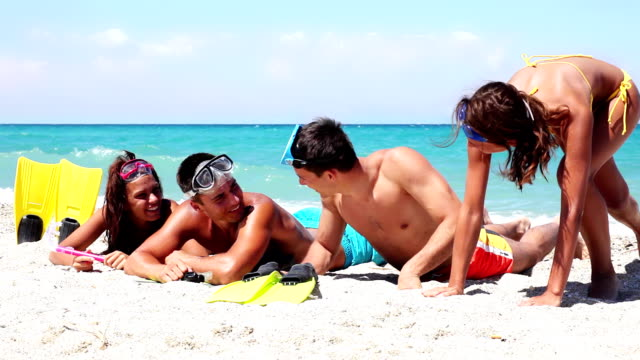 young people with snorkel equipment resting on the beach. - beautiful people stock videos & royalty-free footage