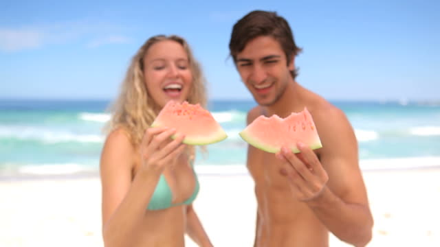 young people with watermelon - aufblenden stock-videos und b-roll-filmmaterial