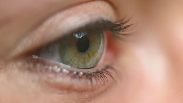 ECU Young person opening grey and hazel colored eye