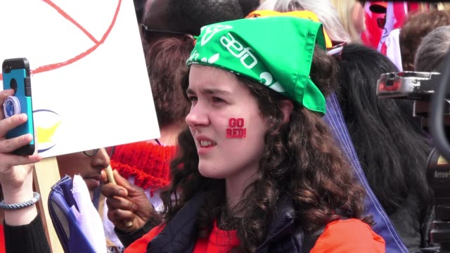 a young person with a sticker in her face reading 'go red' general view of the protest in queen's park thousands gathered to protest the education... - sticker stock videos and b-roll footage
