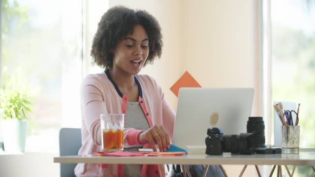 young photographer working from her studio - cold drink stock videos & royalty-free footage