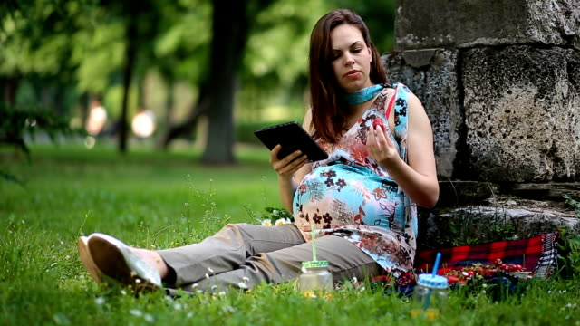 Young Pregnant Woman Relaxing In Nature