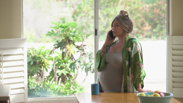 MS Young pregnant women wearing a kimono talking on the phone