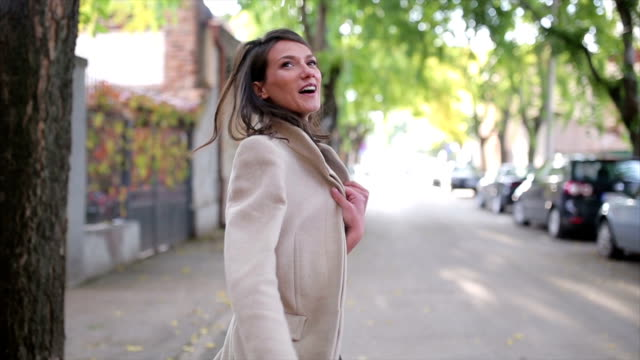 young pretty business woman walking on the street. - autumn stock videos & royalty-free footage