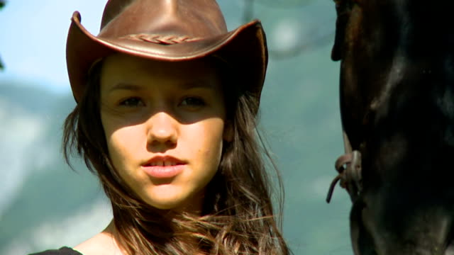 hd: young pretty cowgirl in nature - cowgirl stock videos & royalty-free footage