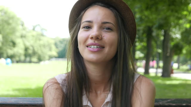 young pretty girl in the park - winking stock videos & royalty-free footage